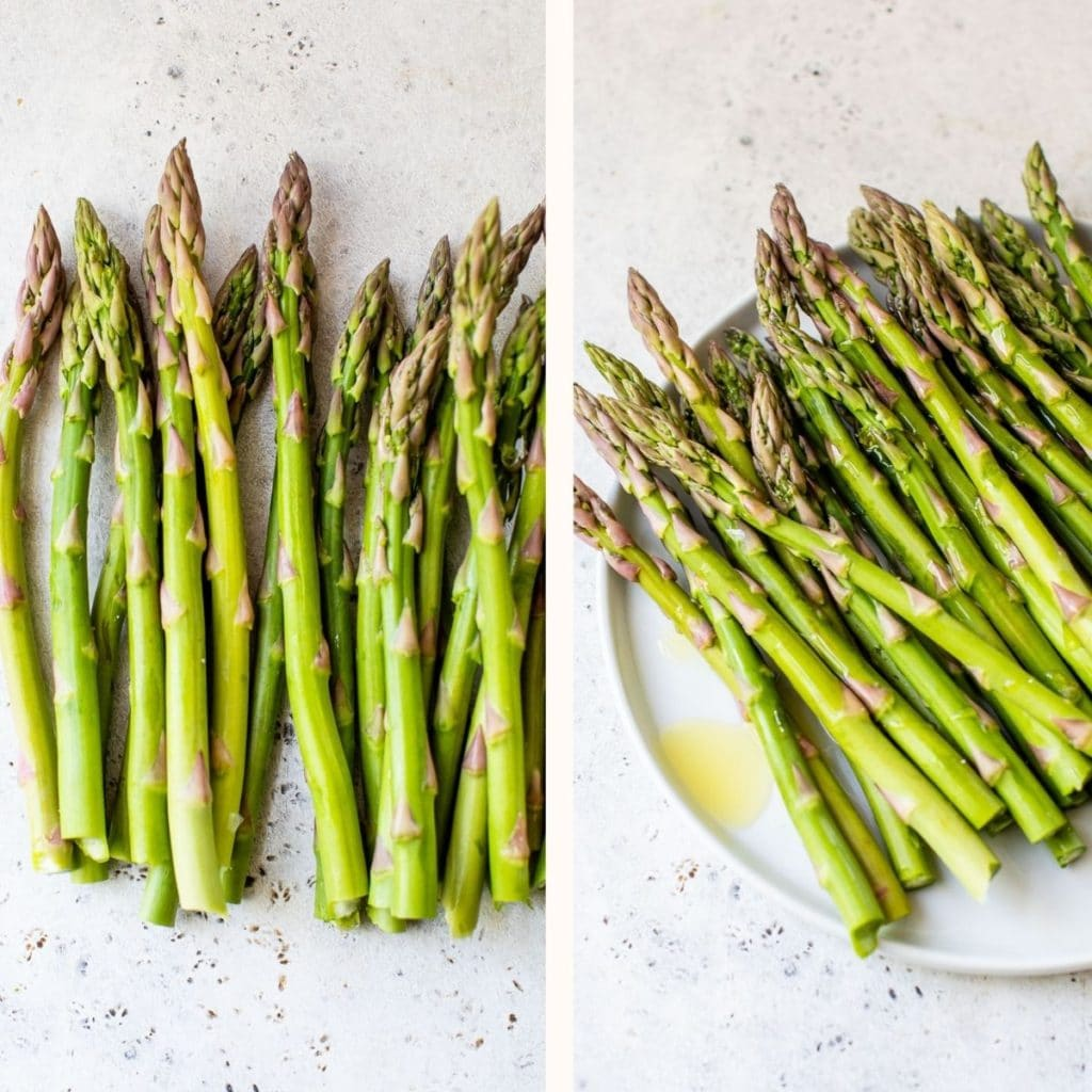 raw asparagus on a plate drizzled with olive oil