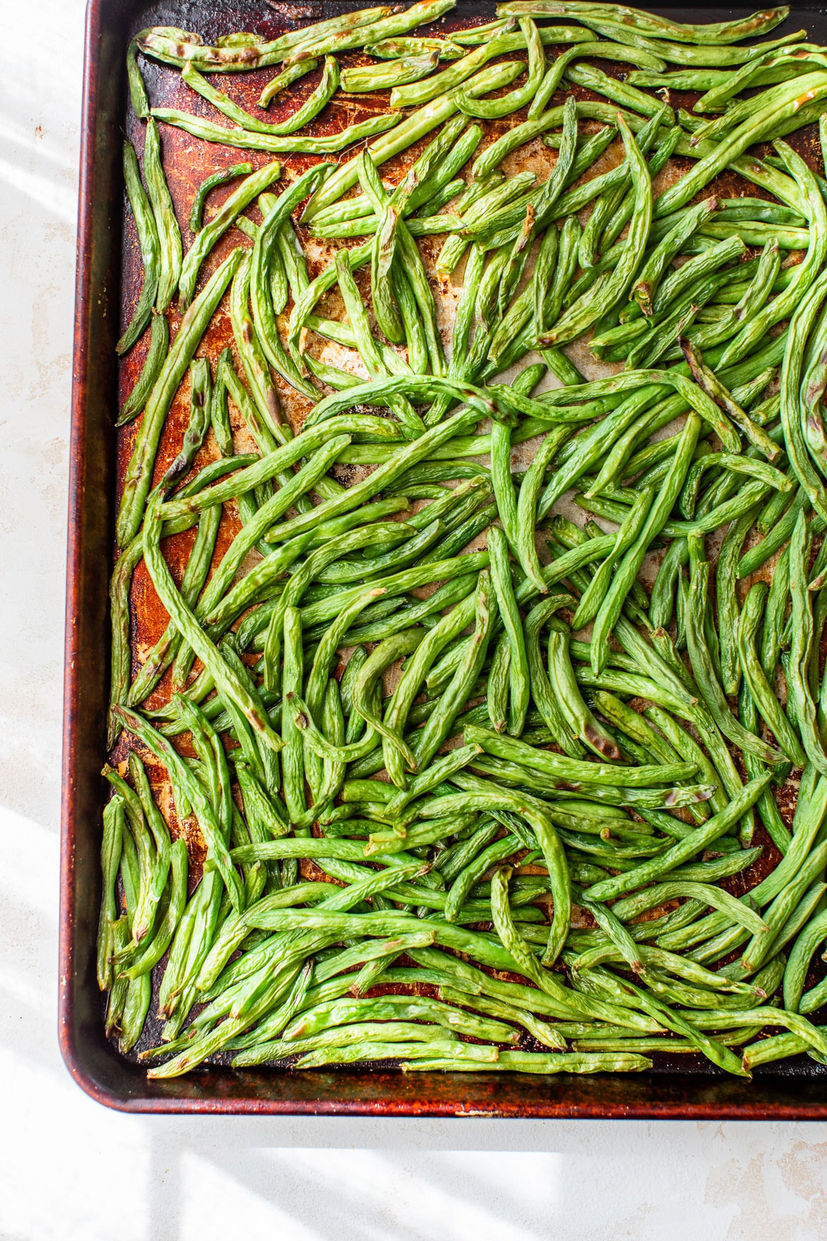 green beans on a large baking sheet
