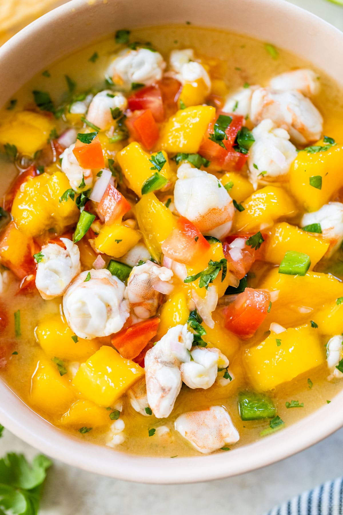 mango shrimp ceviche in a pink bowl