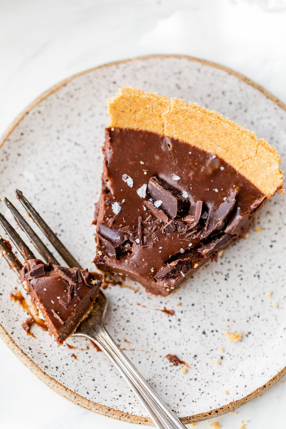 a slice of pie on a plate with a bite taken out of it