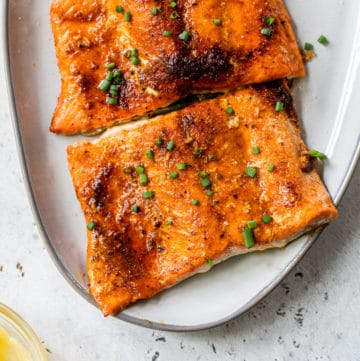 salmon fillets on a platter sprinkled with chives