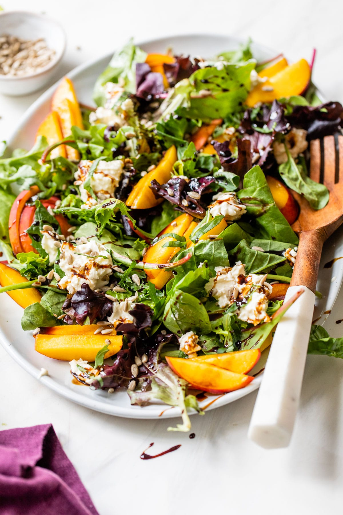 lettuce, peaches and burrata cheese drizzled with balsamic