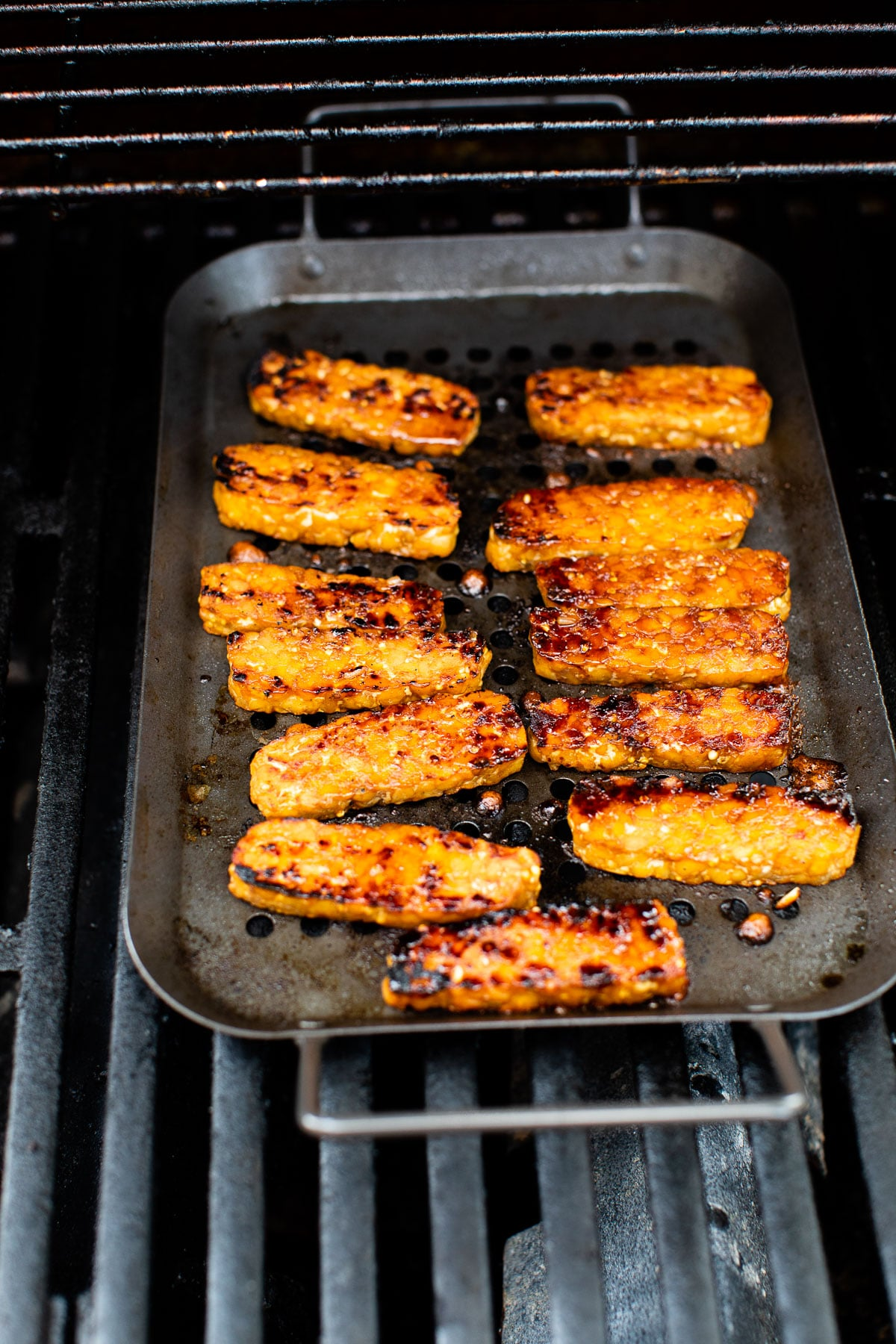 tempeh on a grill grate on the grill