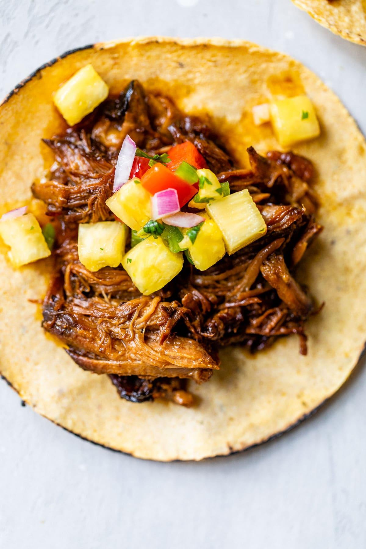 close up photo of a pork taco