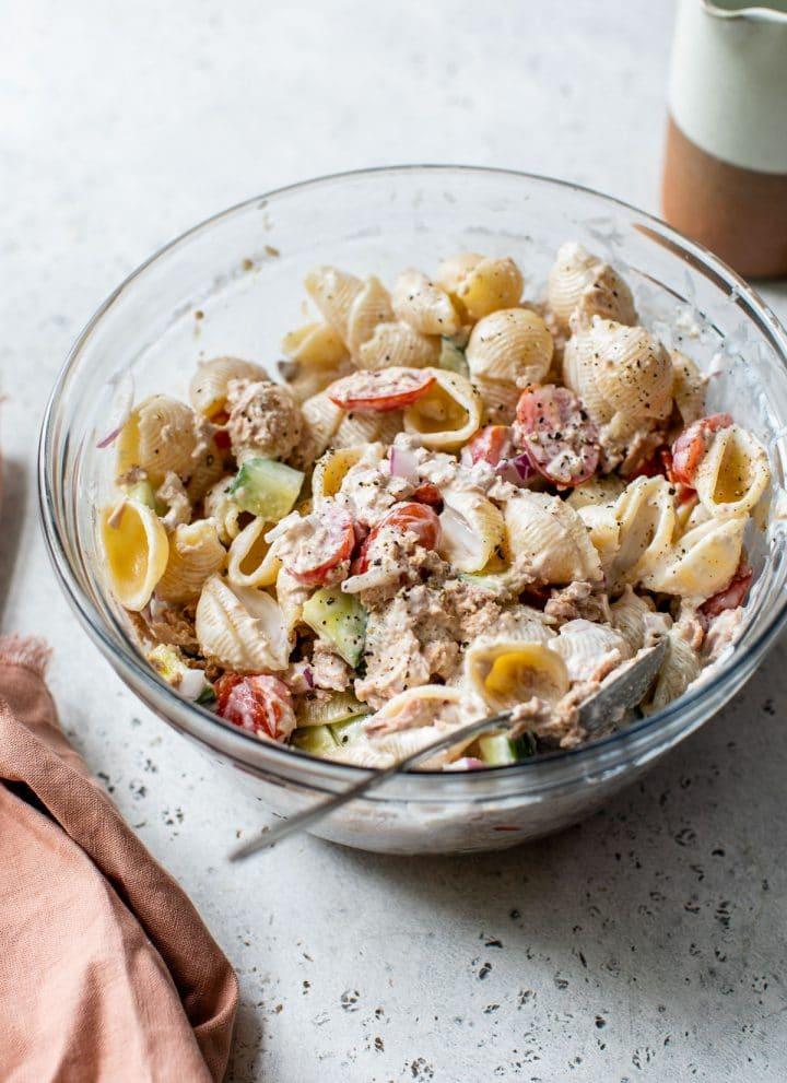 creamy tuna pasta salad in a glass bowl