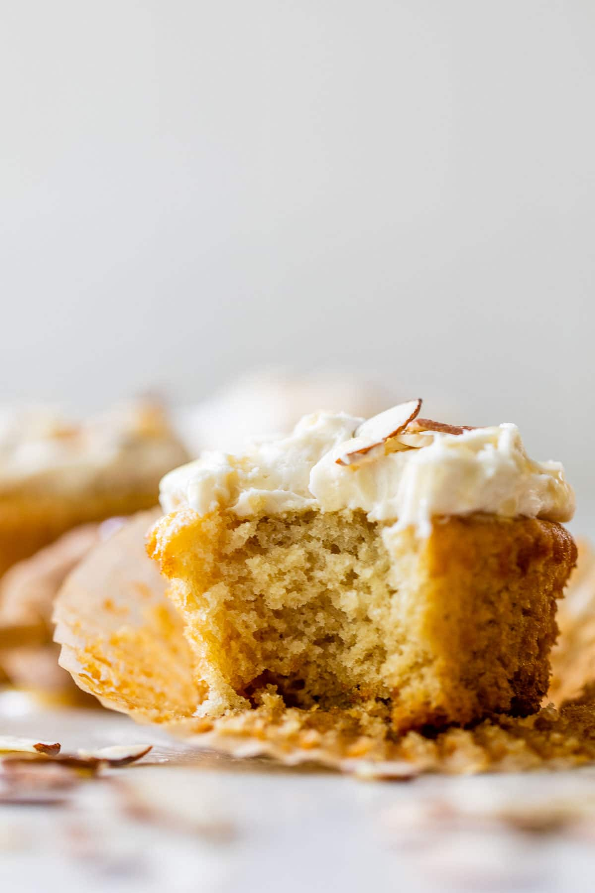 a yellow cupcake with a bite taken out of it