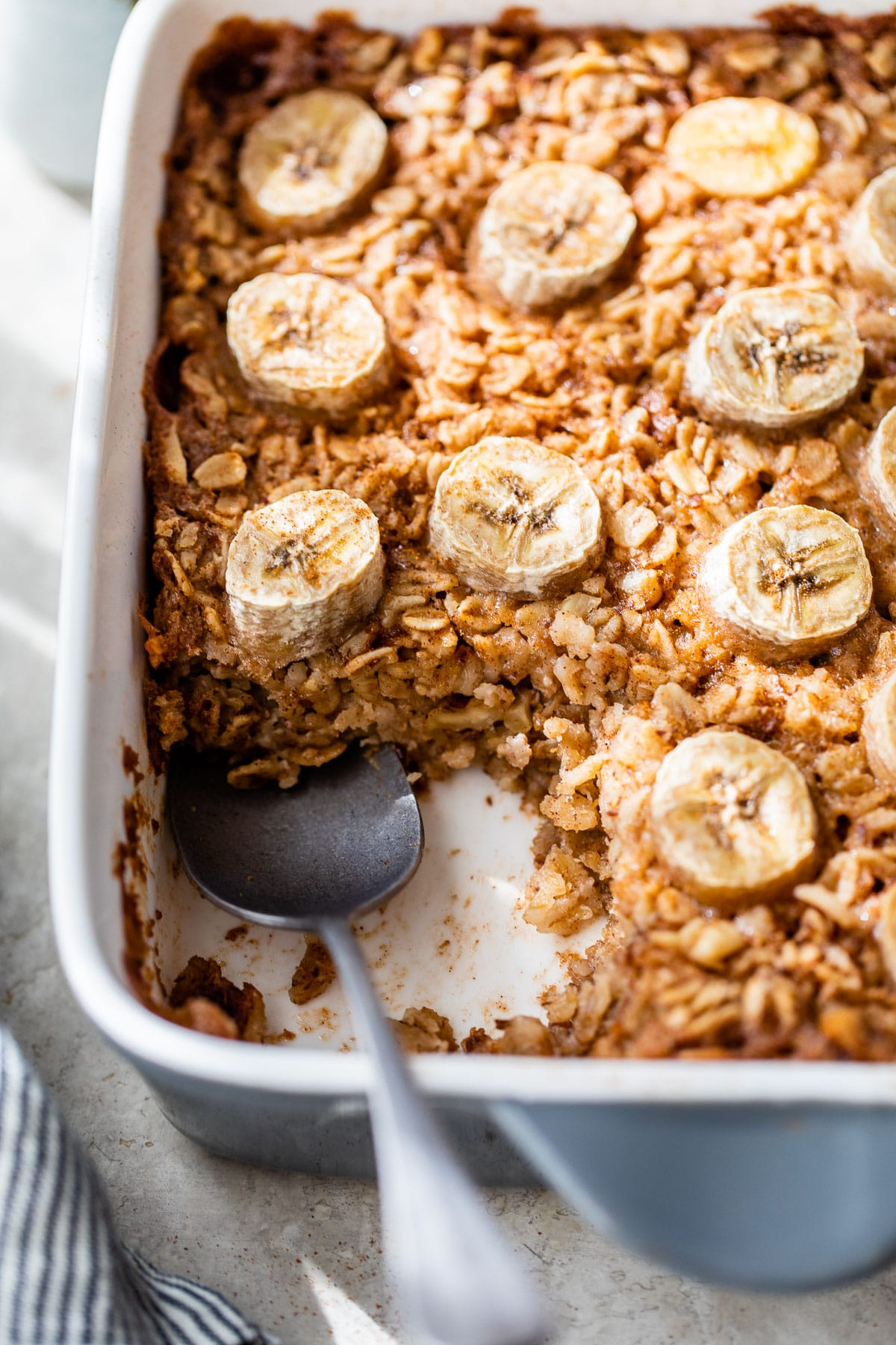 oatmeal in a baking dish topped with sliced banana