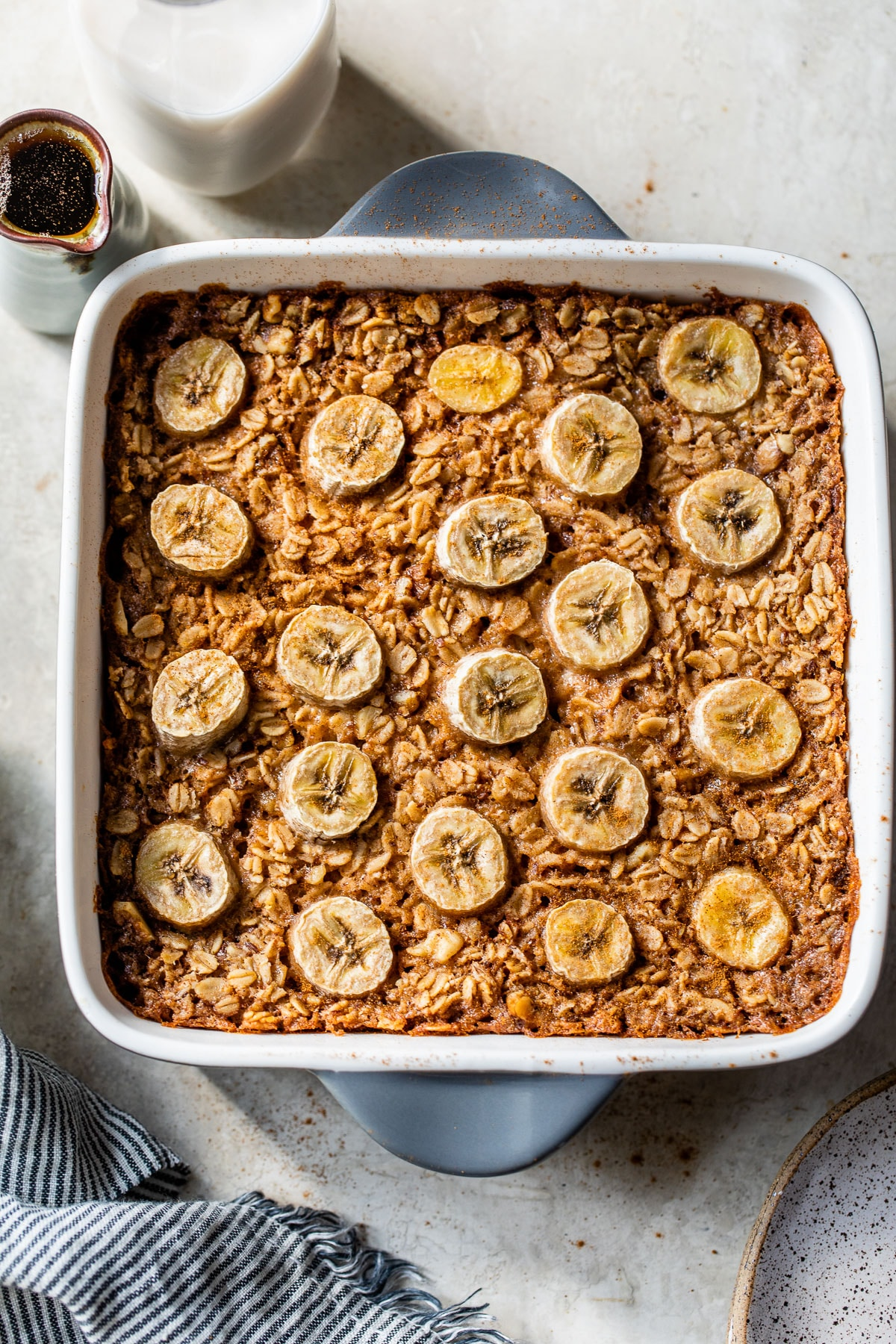 baked oatmeal with banana in a square baking dish