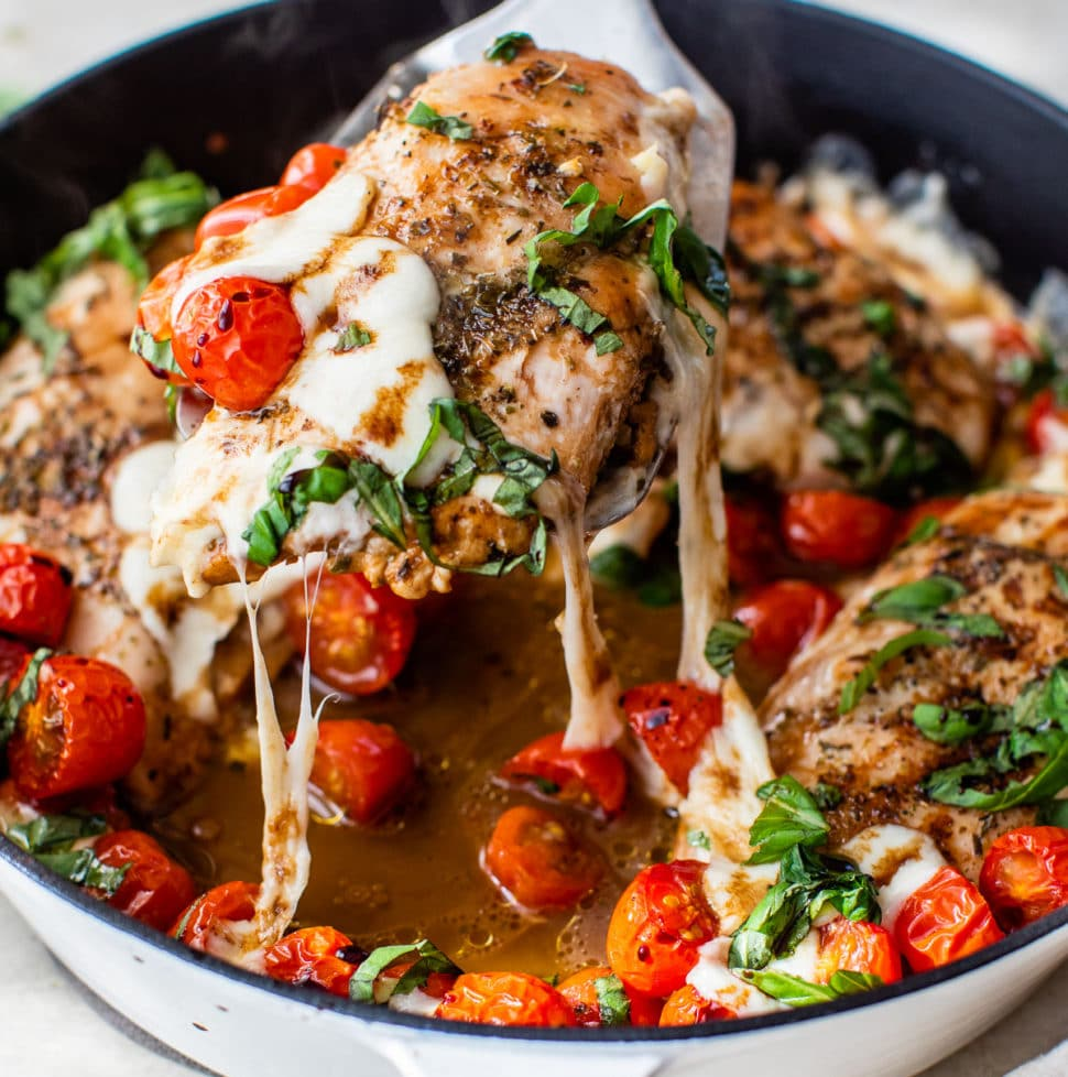 chicken topped with tomatoes and melted mozzarella cheese