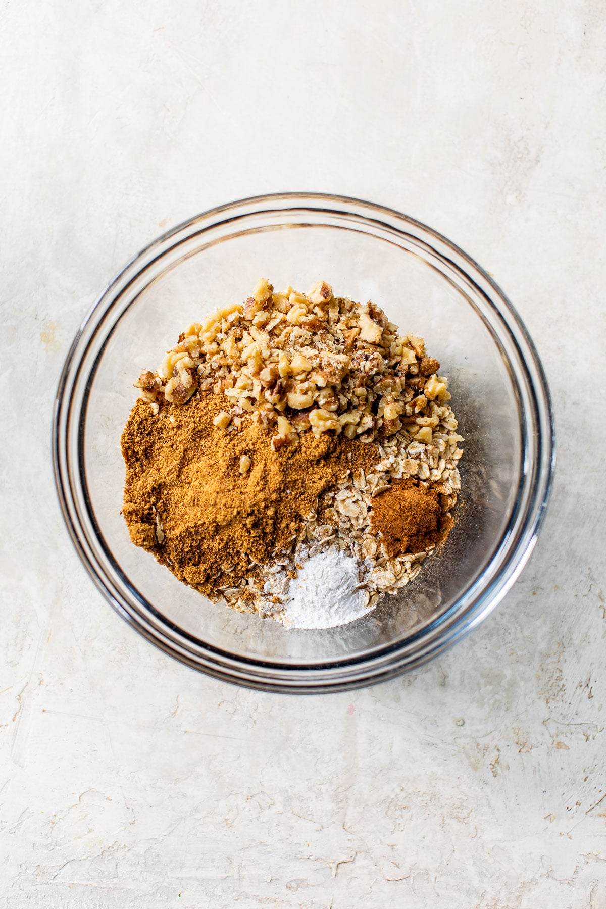 dry oatmeal ingredients in a glass bowl