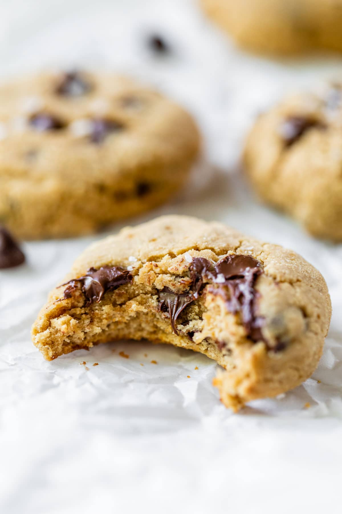 a chocolate chip cookies with a bite taken out of it