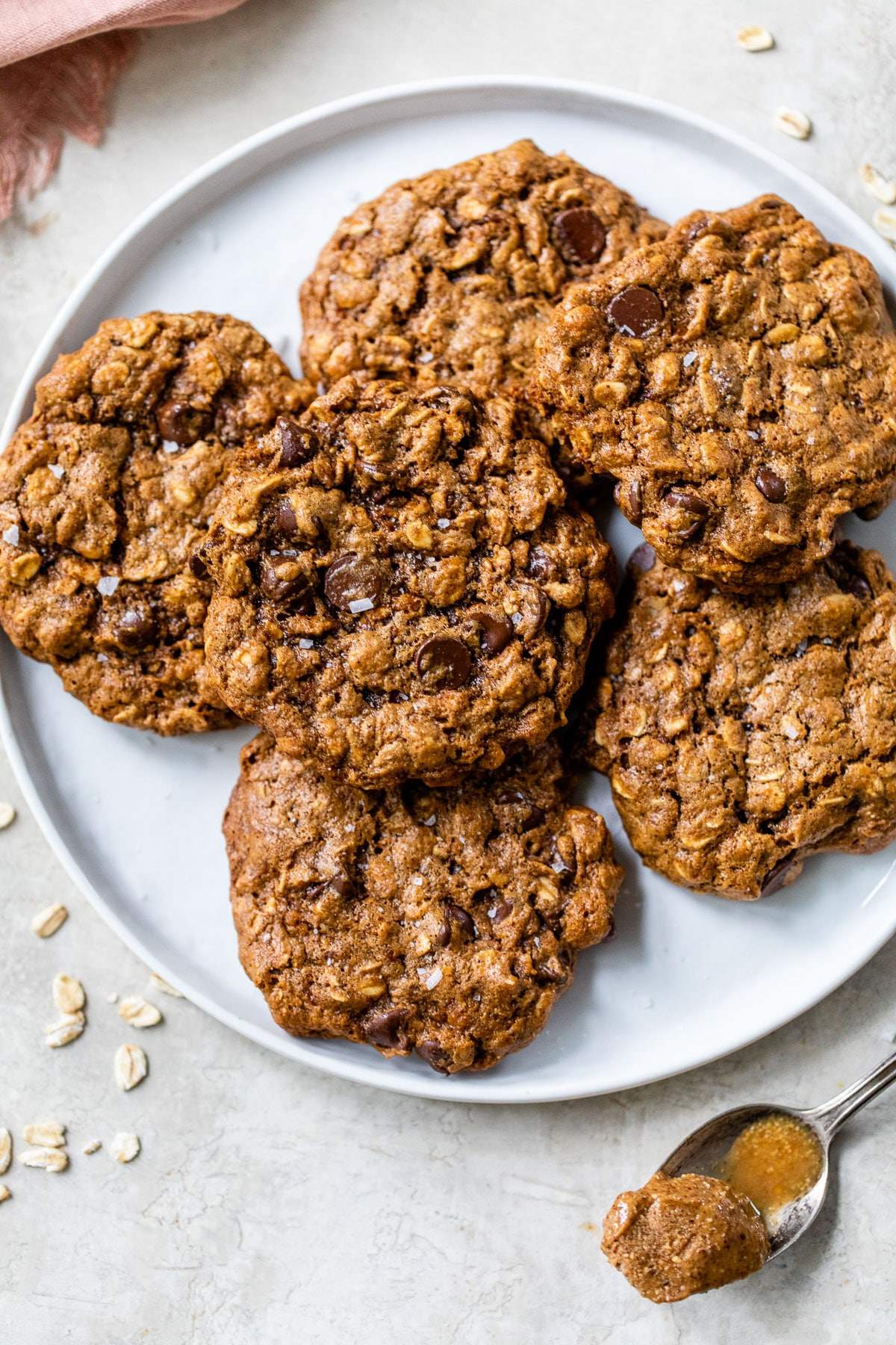 a plate of almond butter oatmeal cookies with chocolate chips