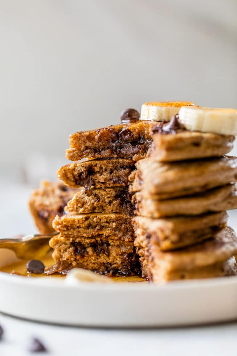 a stack of pancakes loaded with chocolate chips