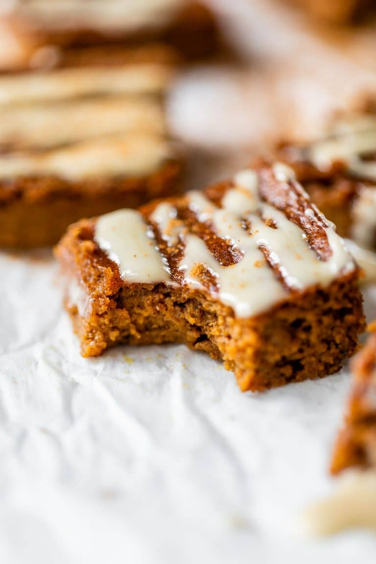 pumpkin bar with a bite taken out of it on parchment paper