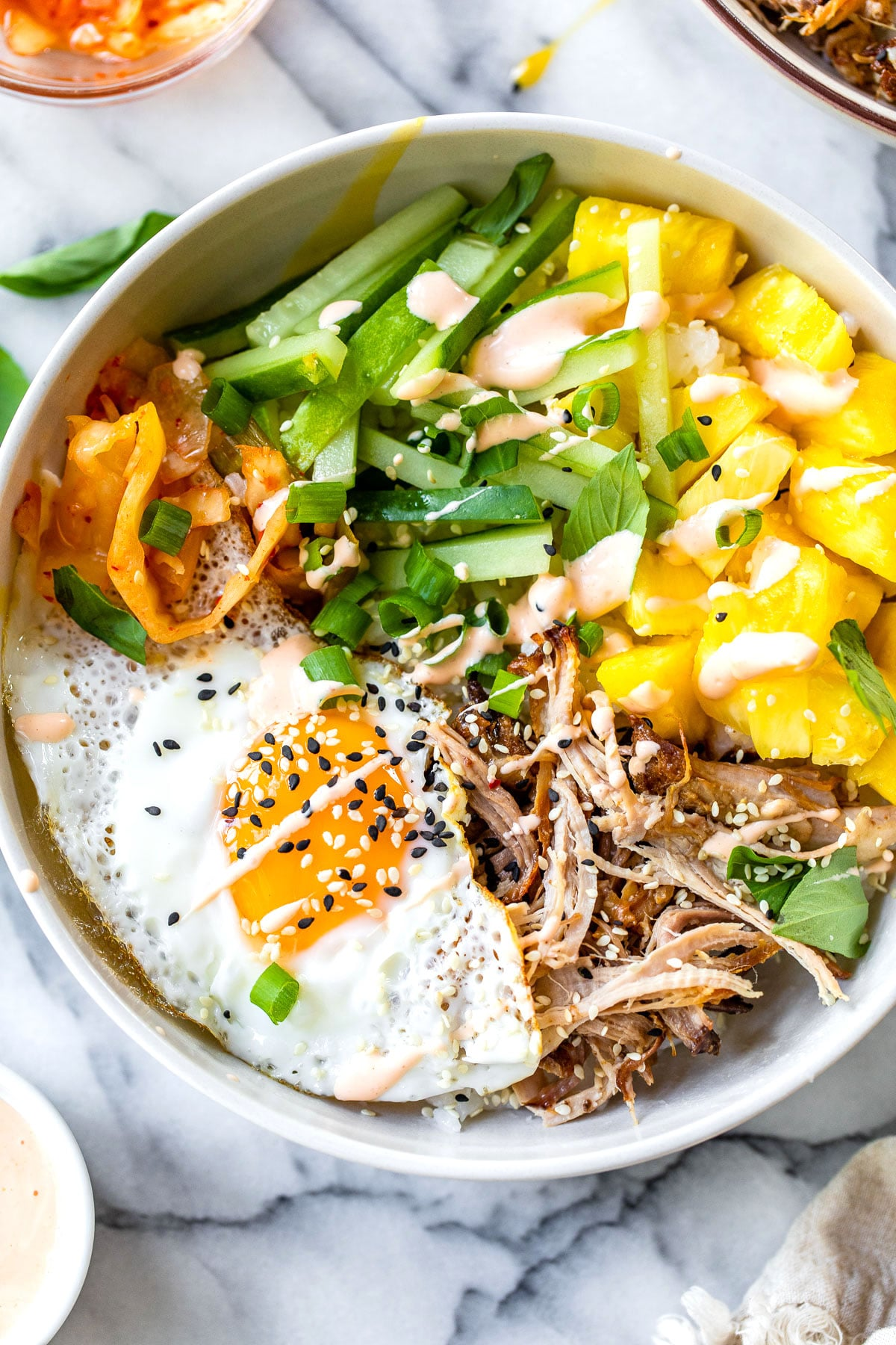 bibimbap with pineapple and a fried egg