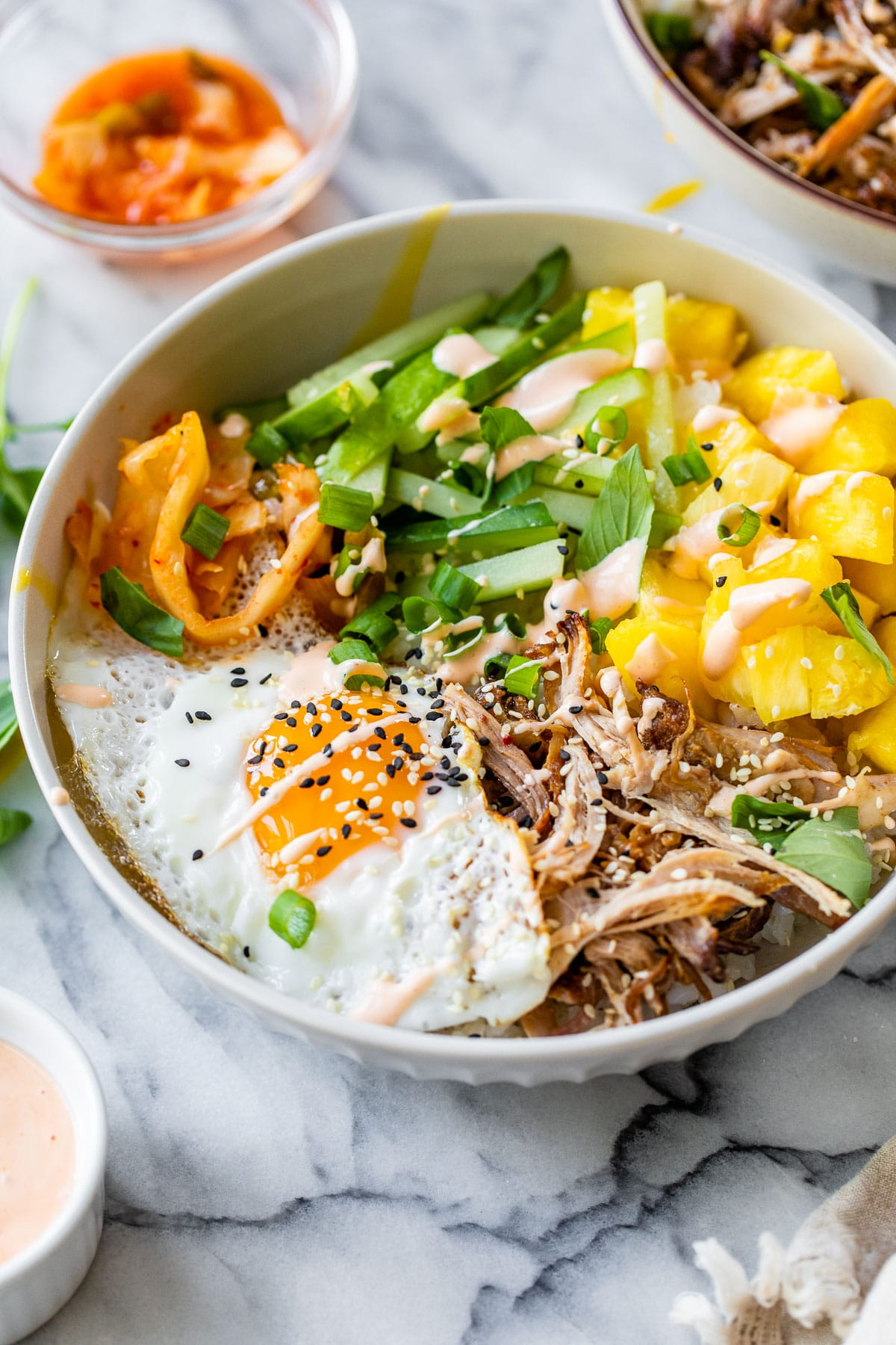 rice bowl with pulled pork, pineapple and a fried egg
