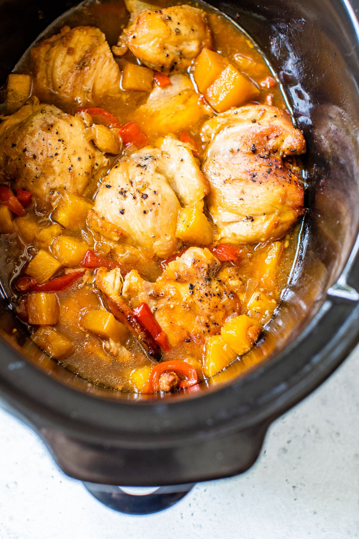 cooked chicken and veggies in a slow cooker