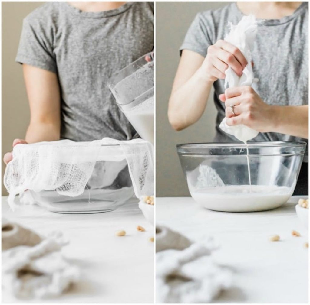someone squeezing milk from a cheese cloth into a bowl