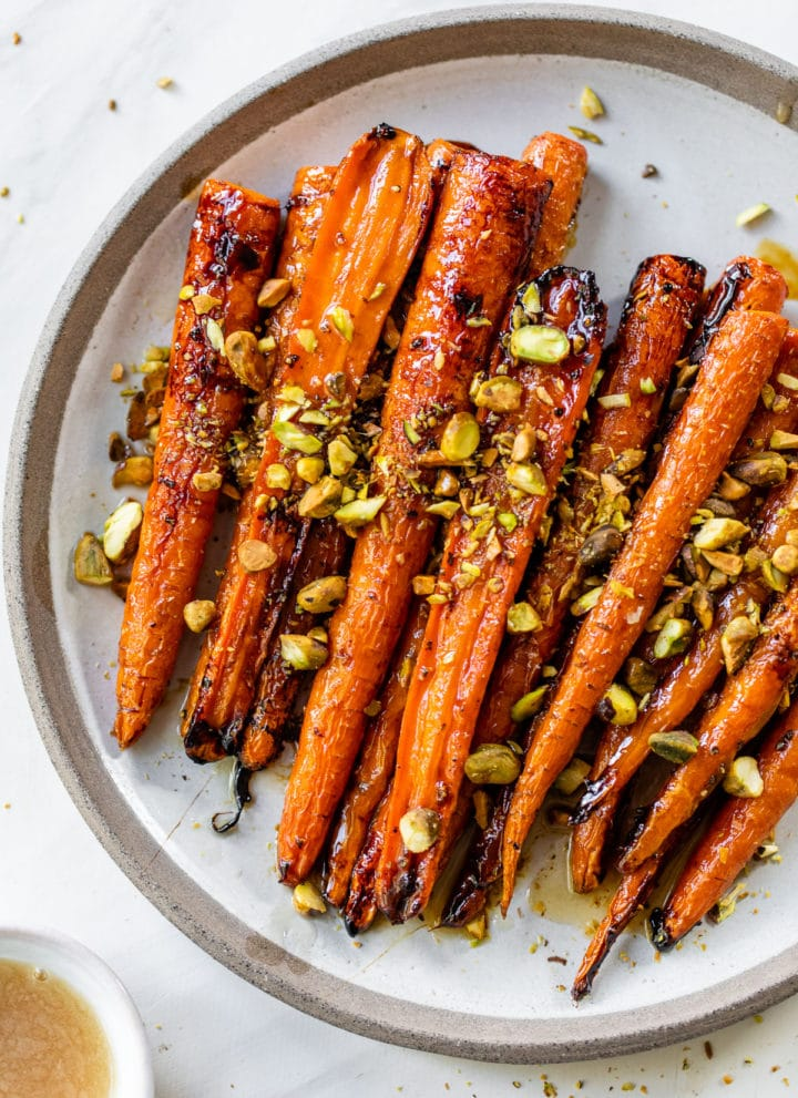 roasted carrots on a plate with pistachios